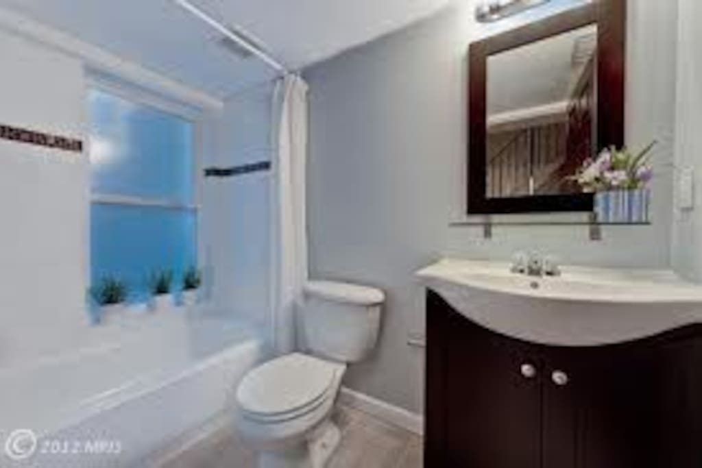 The semi-private bath on the second floor features shower with tub