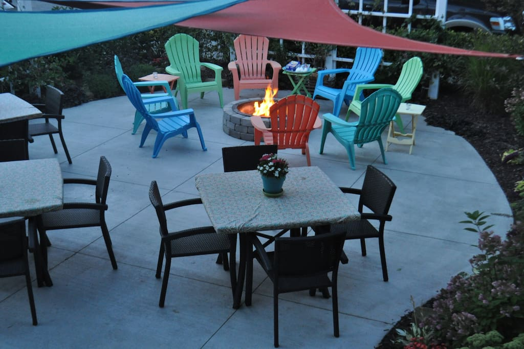 Backyard shared patio with fireplace with adjacent unit perfect for outdoor dining