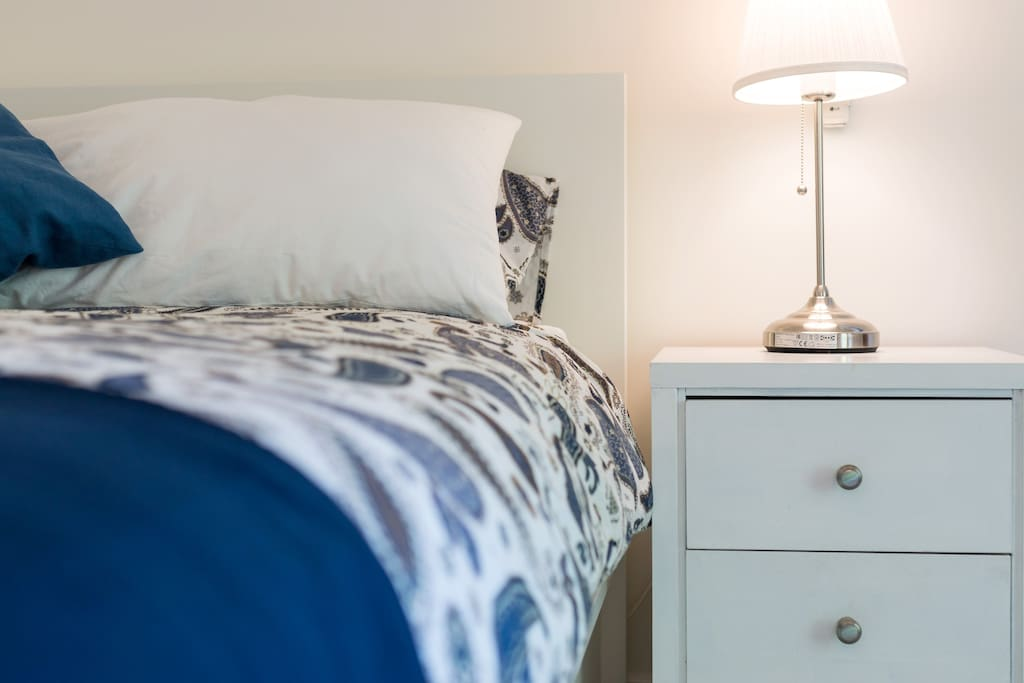 Quality comfy queen bed and styled bedlinen.
