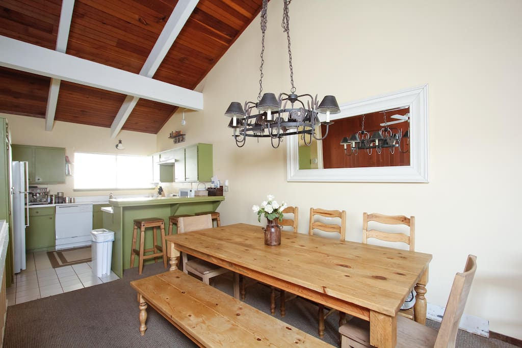 Big dining table next to kitchen makes it easy to entertain.