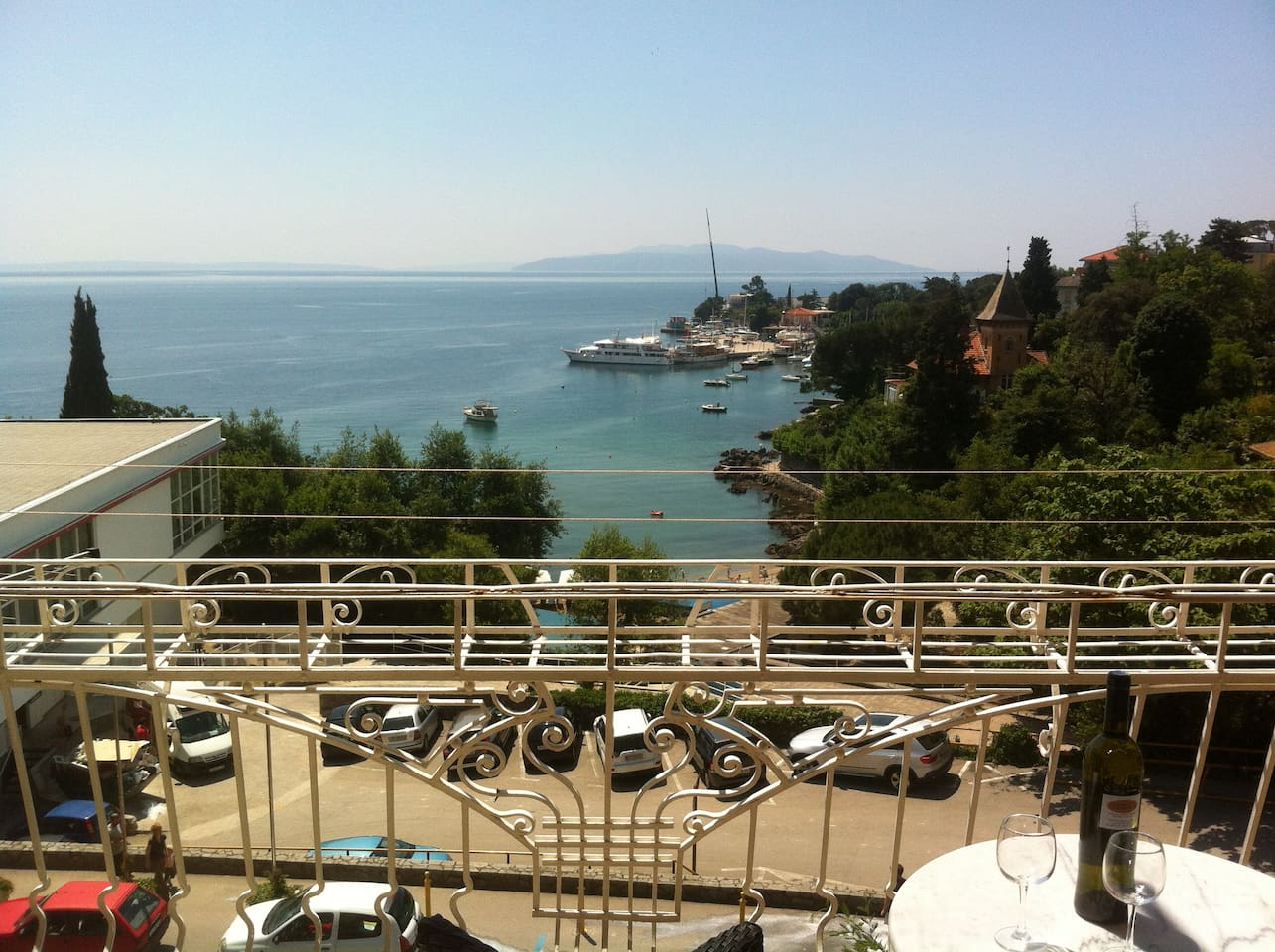 balcony with beautiful view on the beach and harbour.