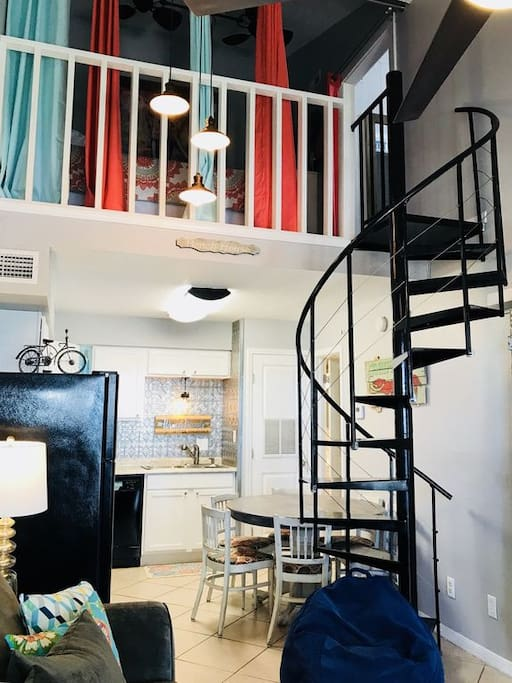 The cool Spiral staircase takes you to the unique loft bedroom, bathroom and additional space  to just kick back and relax in!