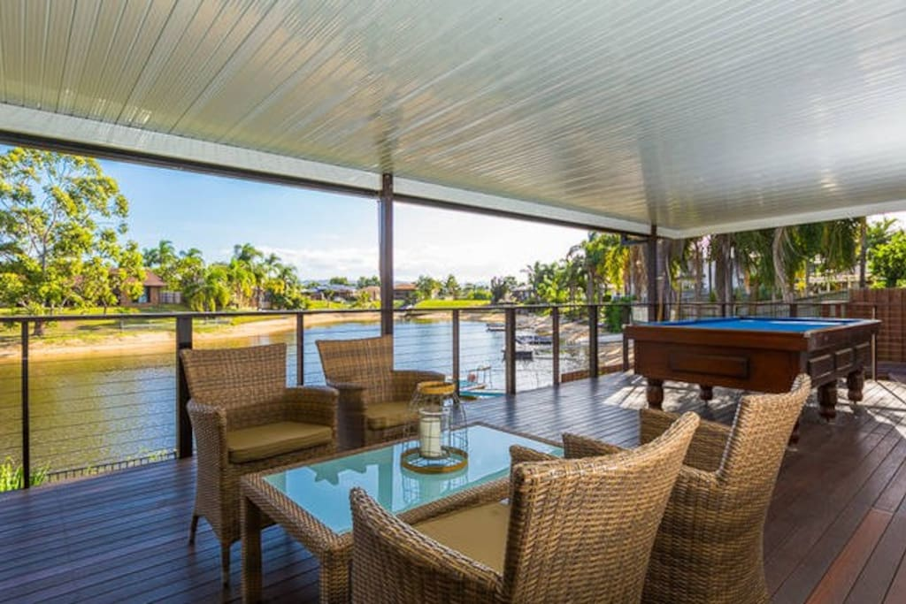Huge completely sheltered rear deck overlooking the water. Pool table, BBQ, dining and sitting areas.