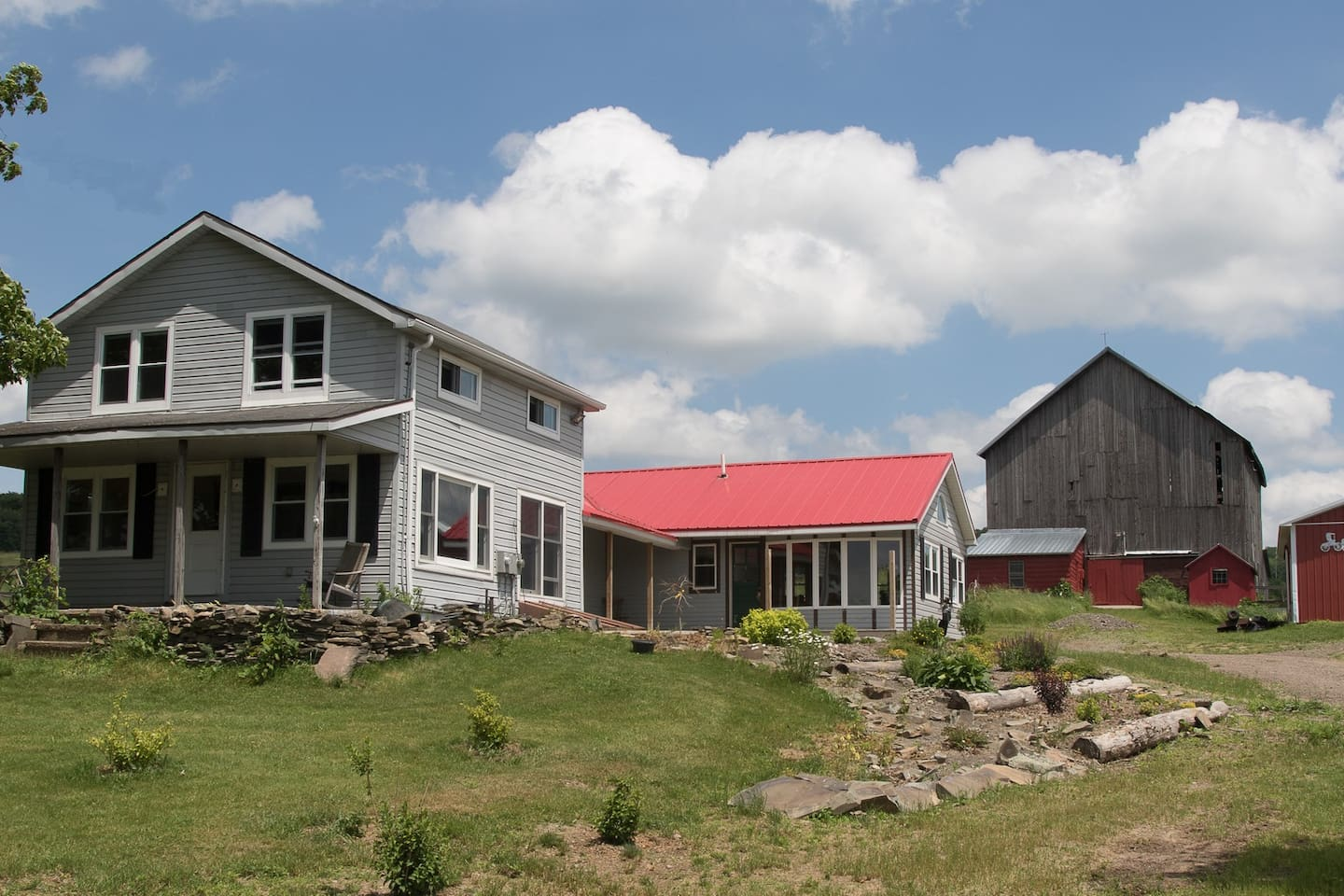 Mills Farm Retreat is the Black Roofed building. The Guest Quarters are Red roofed and the Camper is across the driveway