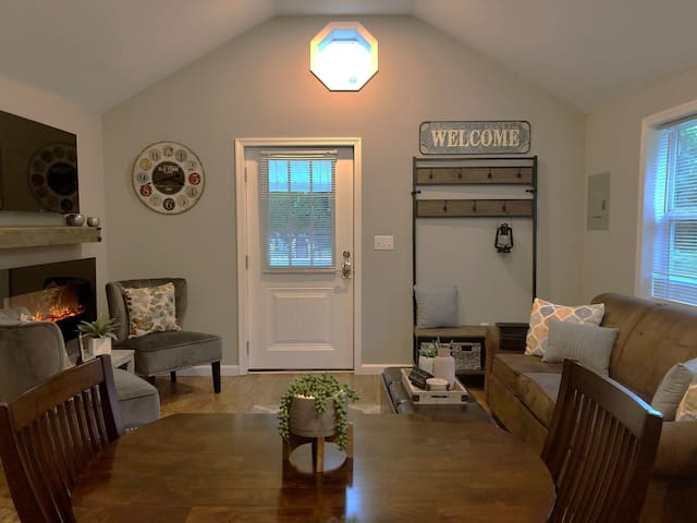 Warm and inviting living area includes electric fireplace, smart tv, board games and books for you to enjoy...