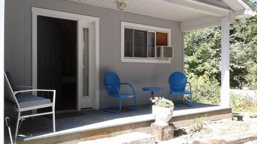 Private covered sitting porch just off Rose Room