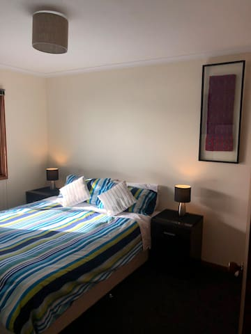 The 2nd Queen bedroom with a firmer, super comfy bed.  Selection of pillows between the rooms: soft, feather, bamboo, memory foam...  for a great night's sleep. Touch lamps and candles for soft lighting and relaxing mood.