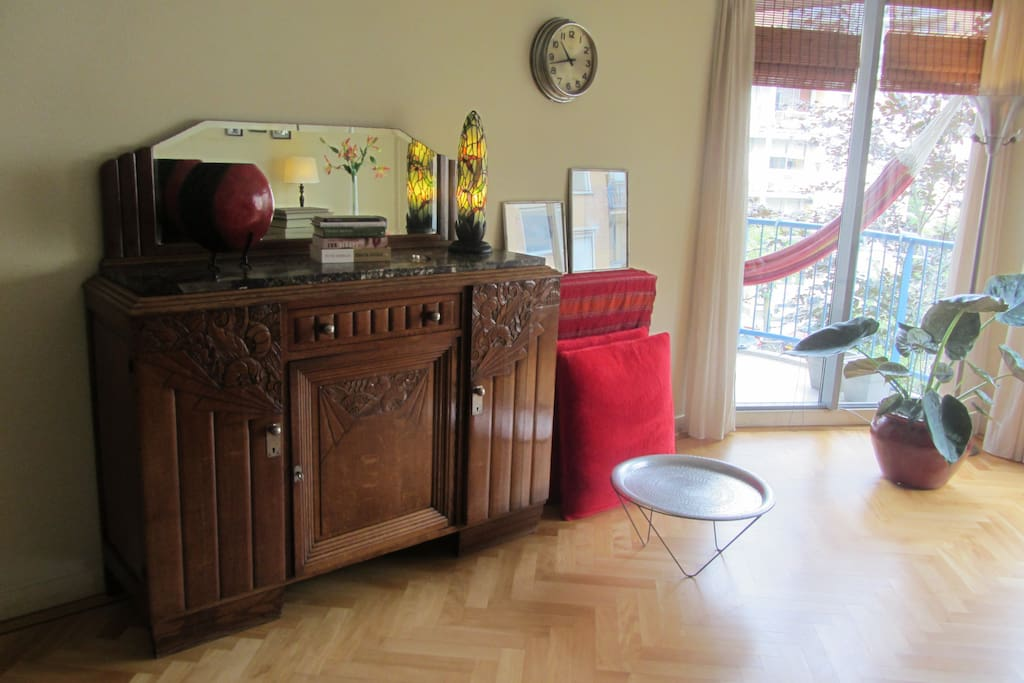 small television is hiding in the antique sideboard