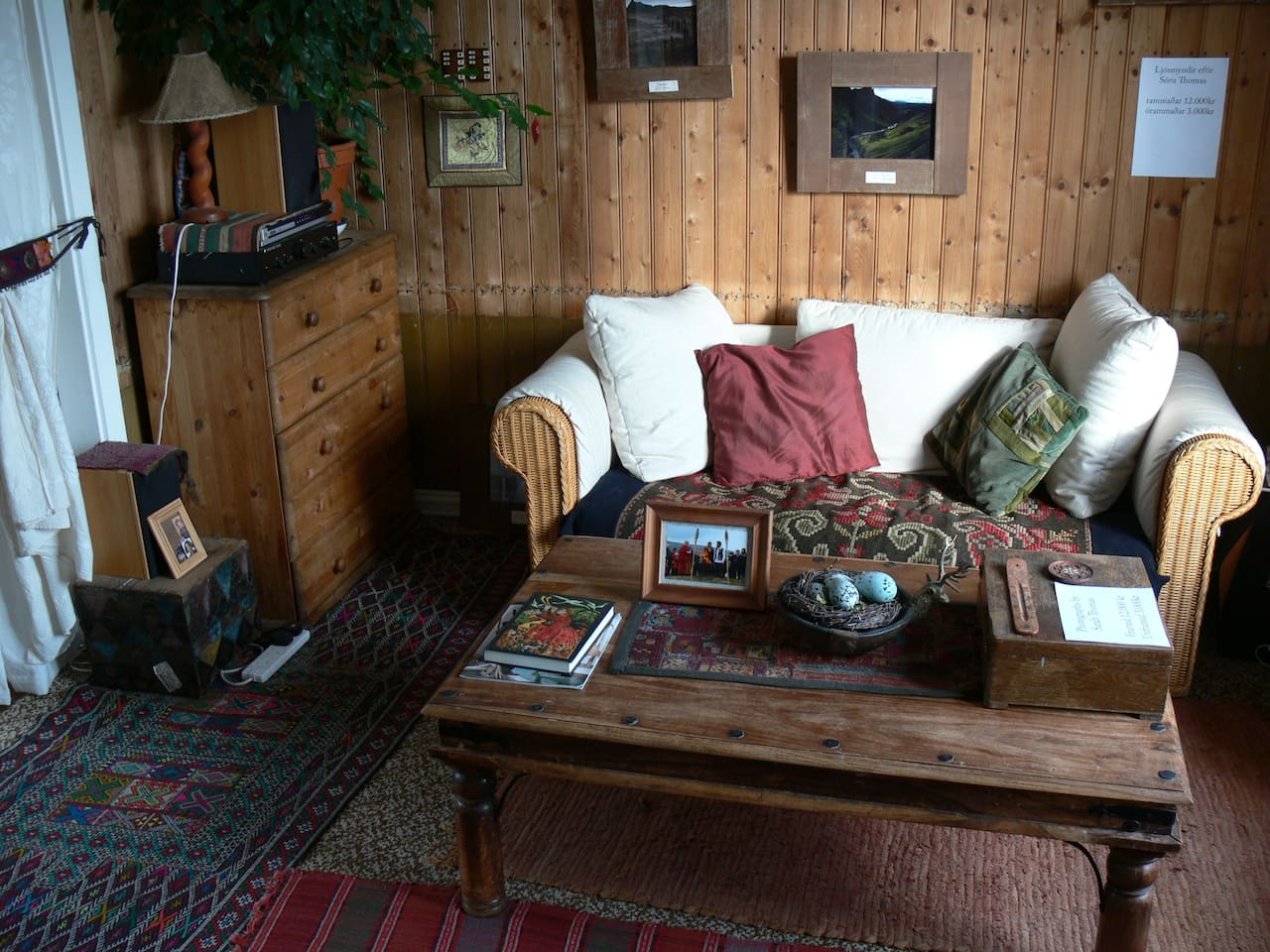 The cosy living room where you'll spend your evenings, perhaps curled up with a book. View to the sea and mountains.