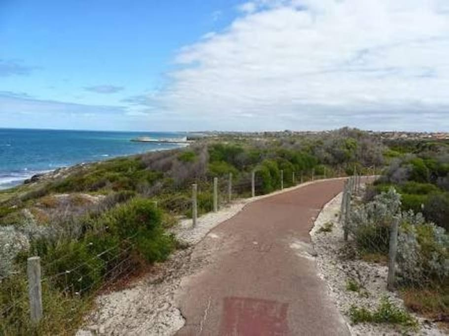 A scenic cycle/walking track follows the coast.