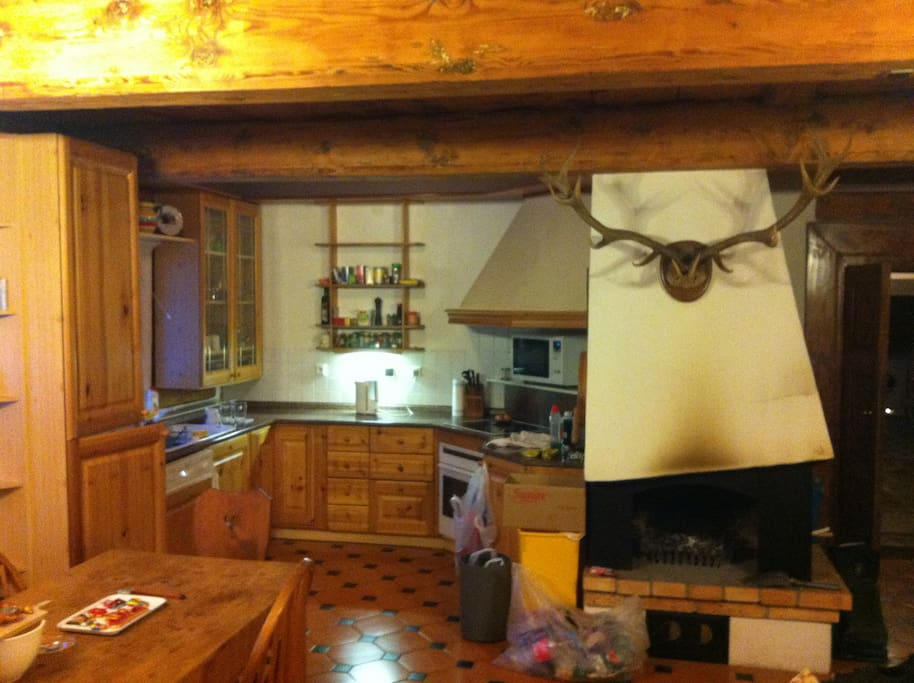 The kitchen and fireplace