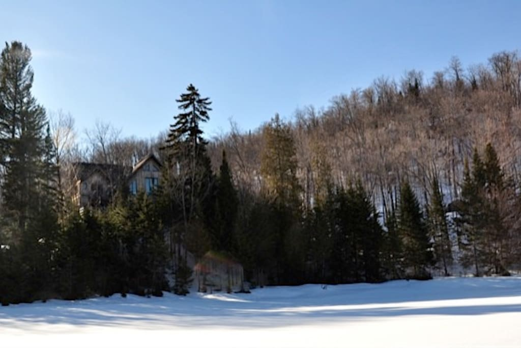 View of the house from the lake, mid-winter