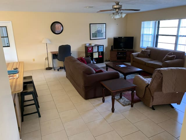 Living room with sofa, sofa sleeper, and recliner. 50 in Smart TV with xfinity.