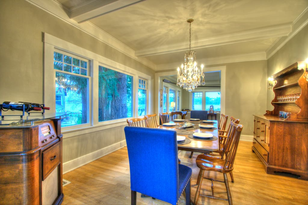Formal dining room with bay view and seating for 8.