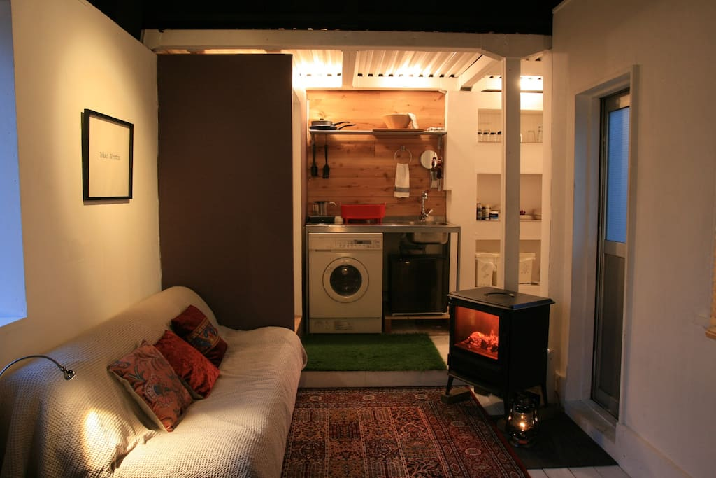 Room at night with electric wood stove