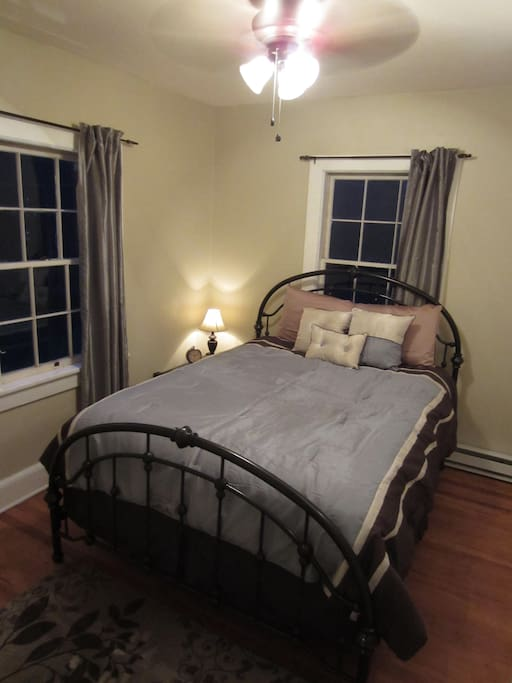 Master bedroom, with queen bed at night.