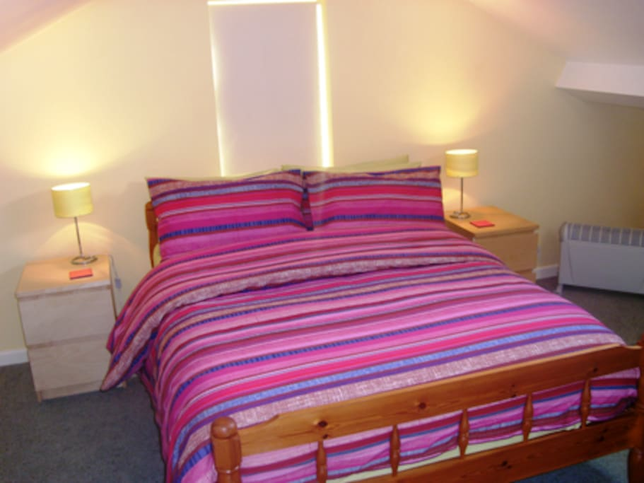 Double bed in upstairs studio area. TV and FREE WiFi available.