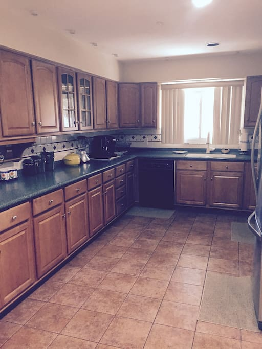 Large and spacious kitchen with corona countertops and new appliances