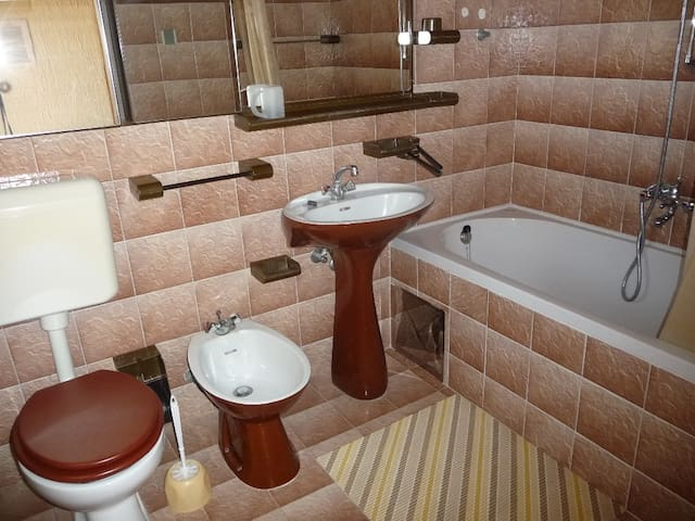bathroom with bad and shower