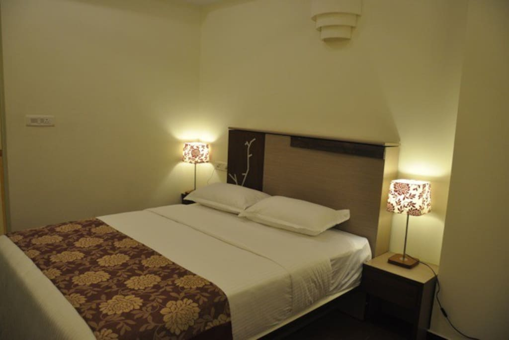 Room with king size bed.