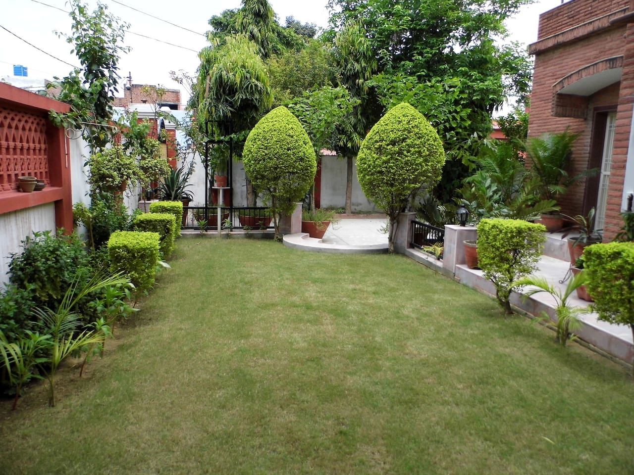 The lush green lawn welcomes you at the entrance.