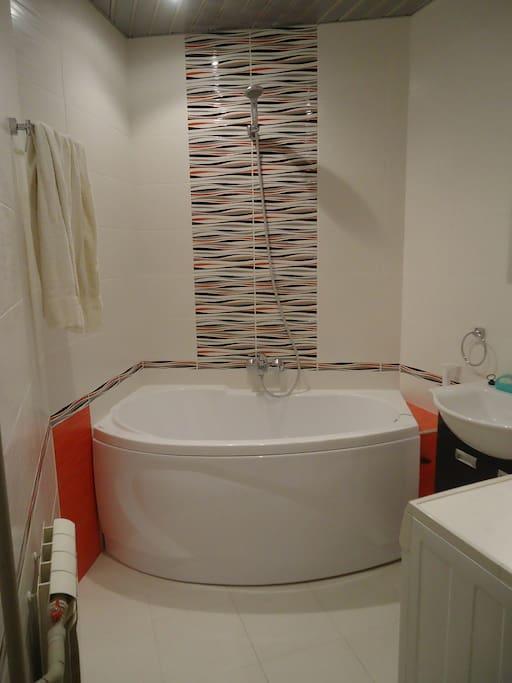 Big bath room with warm floor and washing mashine