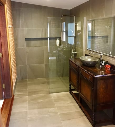 Tile and raw brick master ensuite