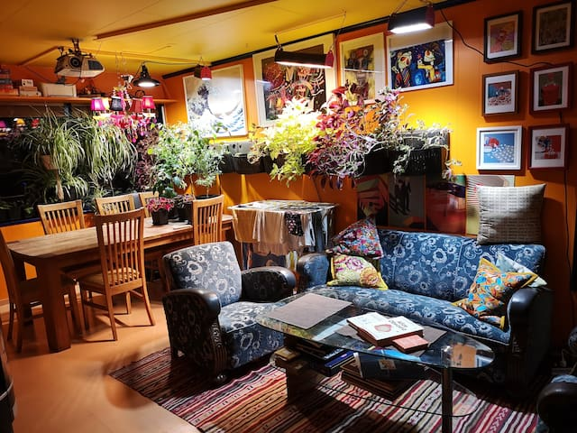 Superb location. Fun eclectic interior with plants