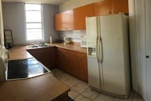 Full kitchen with all you can need to cook and eat.
