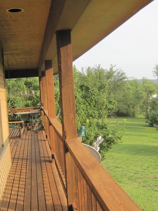 Wraparound deck with a little patio table for a quiet meal