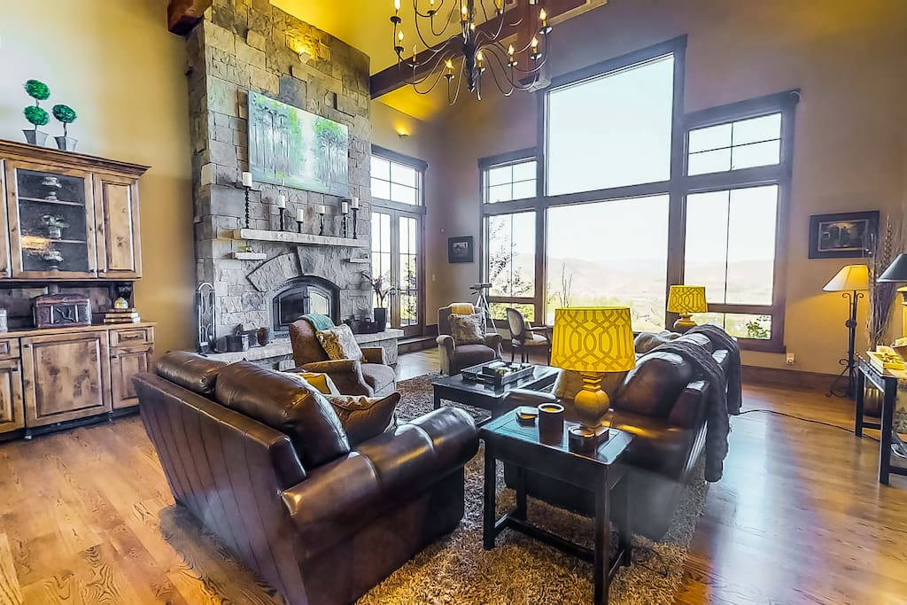 Main living Room Area with High Ceilings, Wood Burning Fireplace and spectacular Western Views.