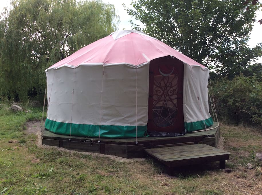 Fifteen foot canvas yurt on a purpose built platform with wood burning stove