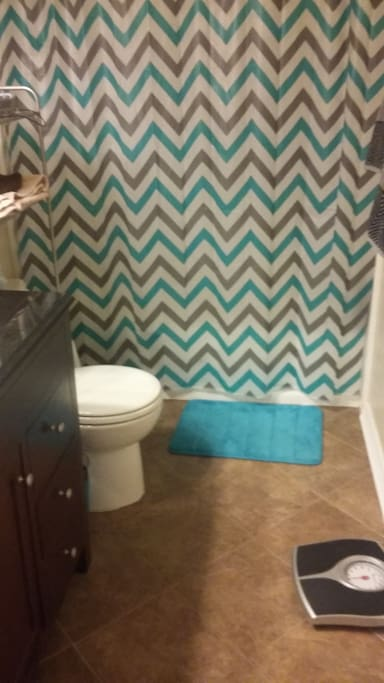 Private guest bathroom with shower, towels provided.