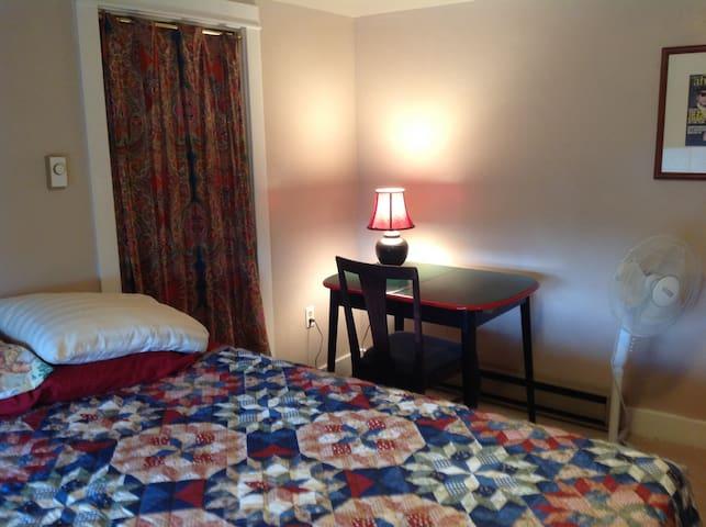 A memory foam Queen sized bed, desk/chair/lamp/fan/baseboard heat and a large closet.