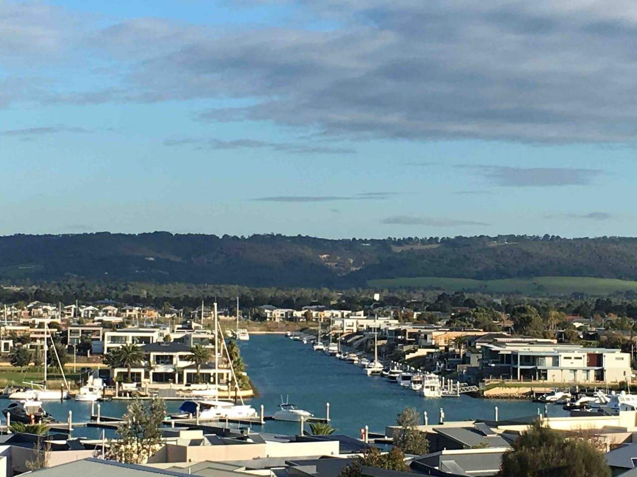 Gorgeous marina views from top story balcony.  Enjoy the evening light show views from the main bedroom.