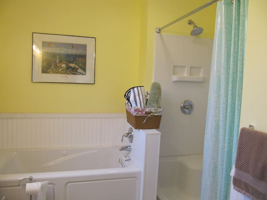 Master bath has jetted tub and large, walk-in shower.  More towels in the basket !
