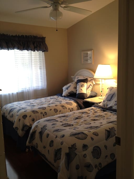 Guest room with twin beds and private bathroom.