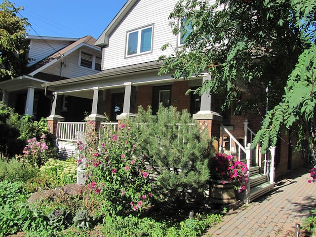 Sunny front porch & walkway to side studio entrance