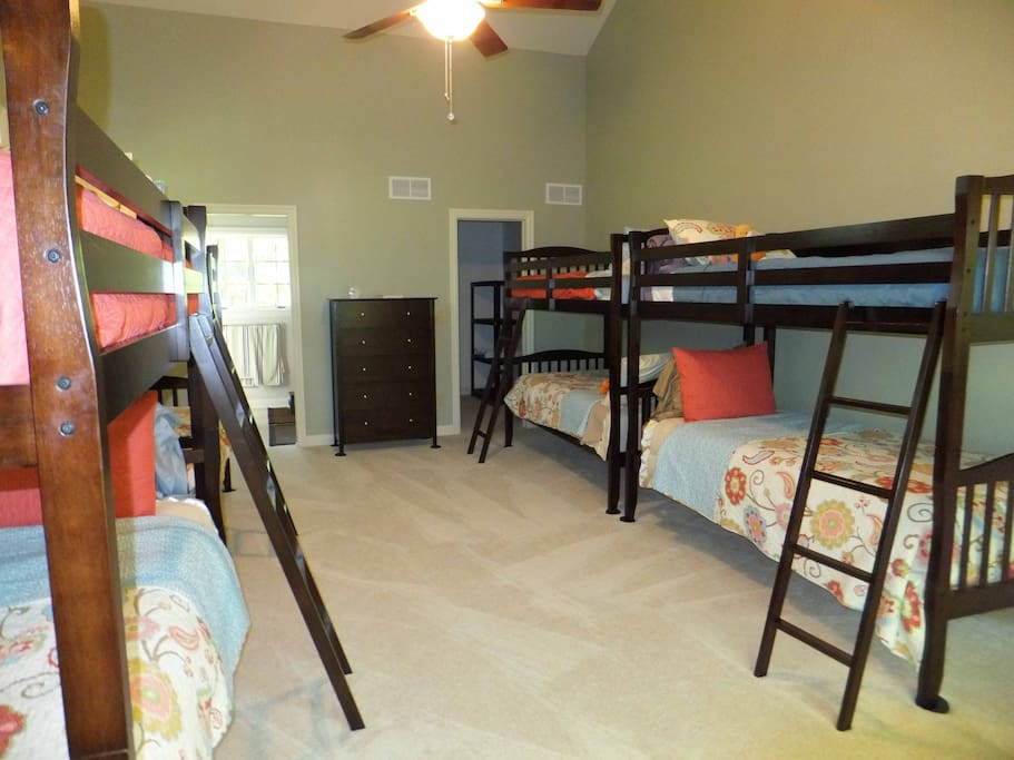Large room with 4 bunk beds, sleeps 8, full bath and double sinks.  Walk in closet.