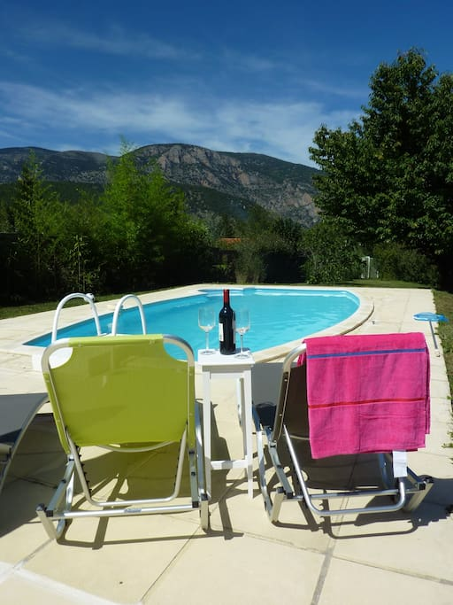Relax with a glass of wine enjoy the pool and the beautiful views.