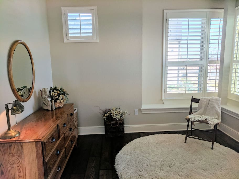 The bedroom faces Southwest with a large bay window and a lot of natural light (and shutters for privacy)
