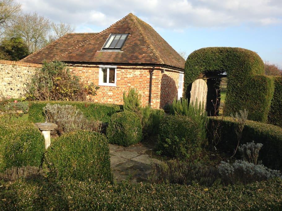 Podlinge Barn taken from cottage garden