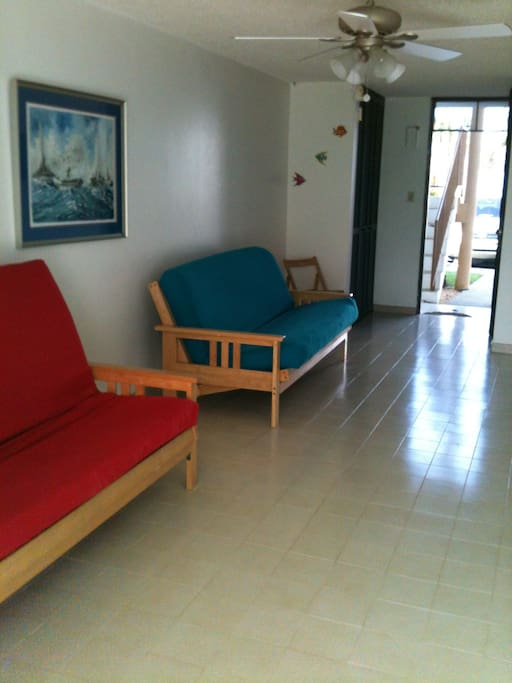 TWO FULL-SIZE FUTONS IN LIVING AREA.