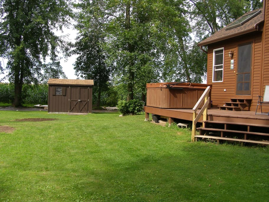 Back yard, shed,deck & jacuzzi, door to kitchen