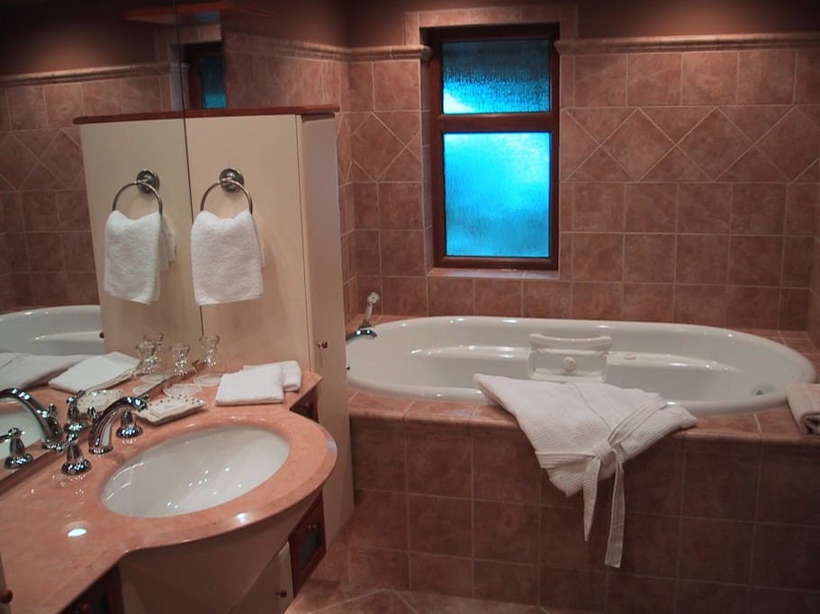 Custom high end finishing designer bathrooms in every suite