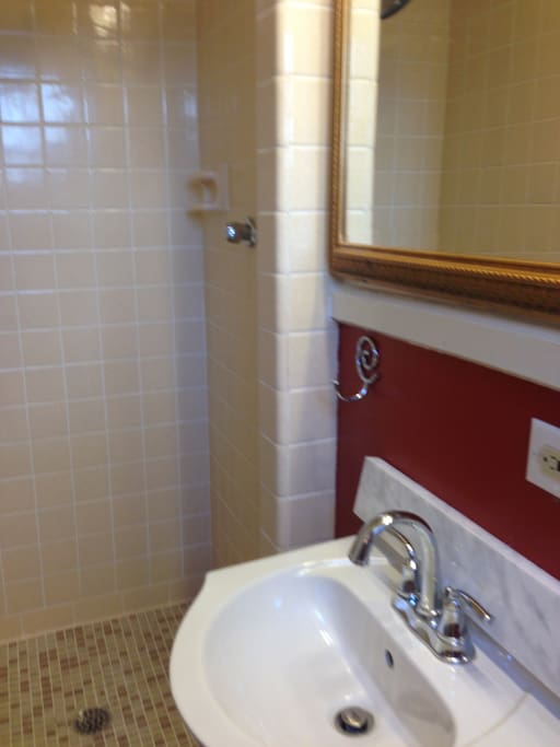 Small bathroom has been recently redone.