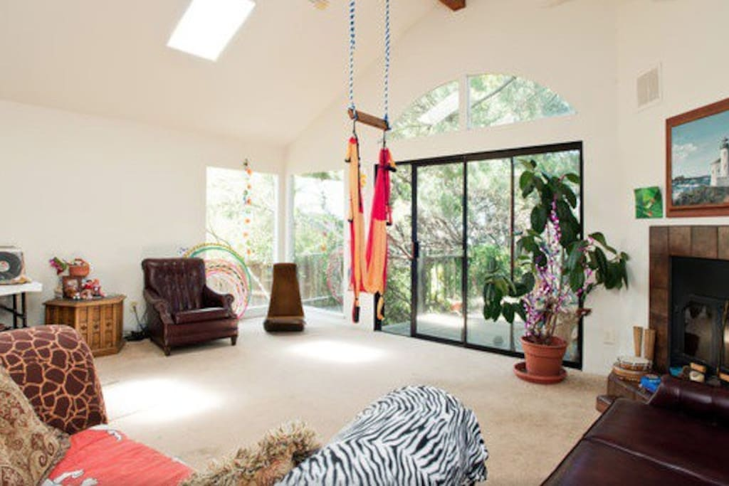 Big living room with yoga inversion swing, room to move.