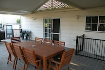 Rear deck and verandah with outdoor setting.