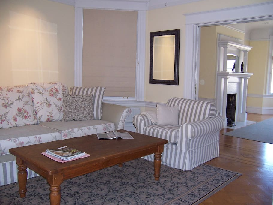 Comfy living room seating area in center of triple parlor, very spacious open feeling, yet cozy for conversation.