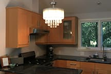Full size kitchen, with a dishwasher, oven, fridge and microwave